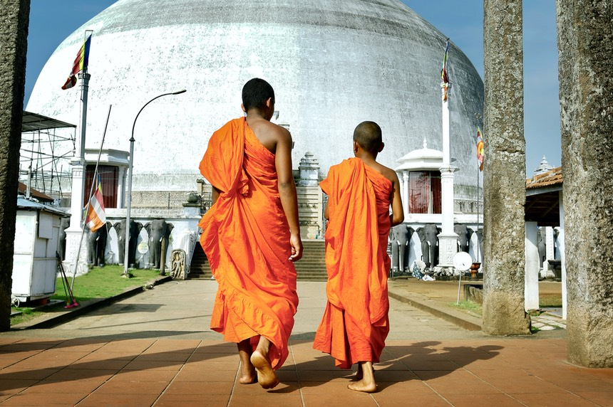monks coming in ruwanwelisaya stupa in anuradhapura historical parc ,Sri Lanka